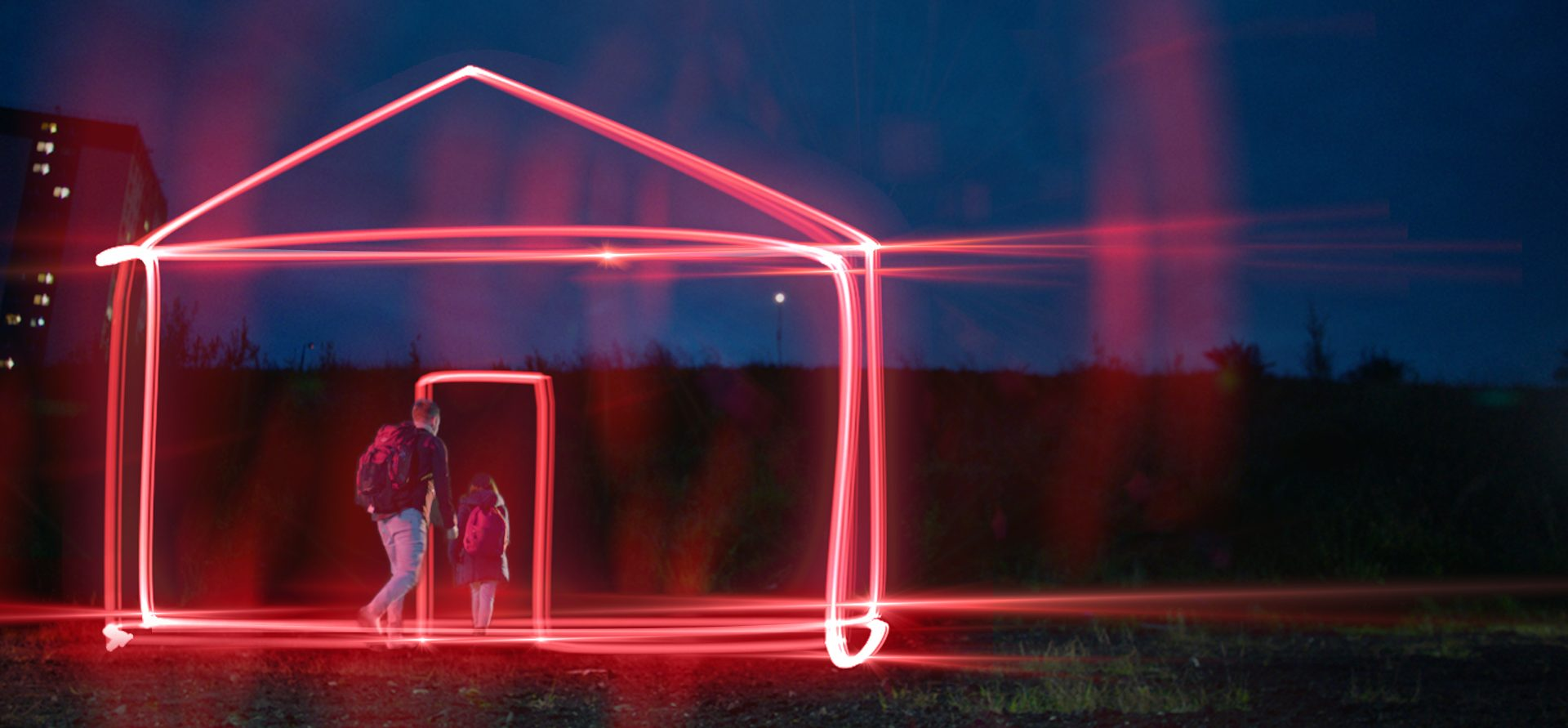 A Man and Child walking through a virtual house door